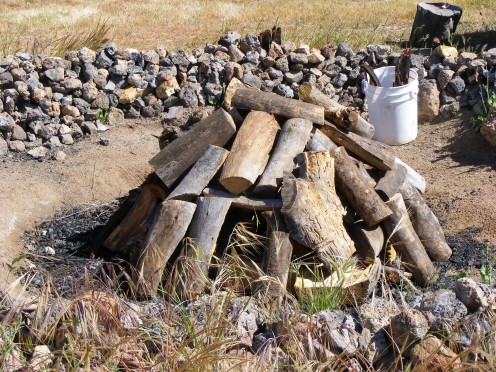 The fire pit for the Native American sweat lodge ceremony is prepared mindfully and respectfully.
