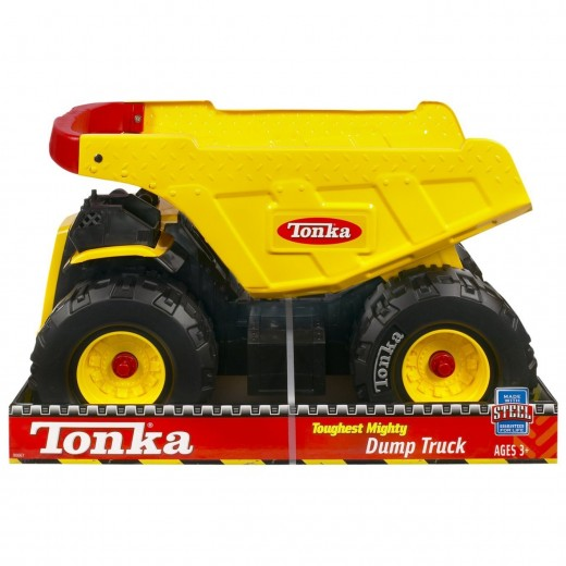 Large hand on the Toughest Mighty Dump Truck by Tonka for boys who love playing in the sand.