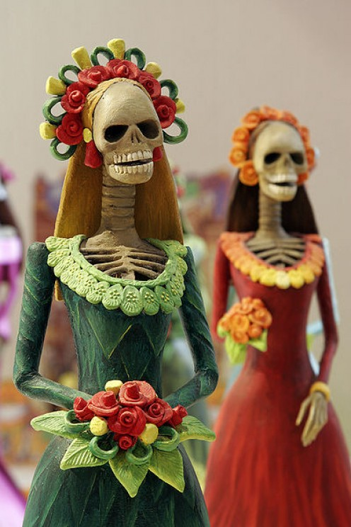 "Artistic manifestations of the ""Day of the Dead"" in Mexico, such as altars and calavera costumes."