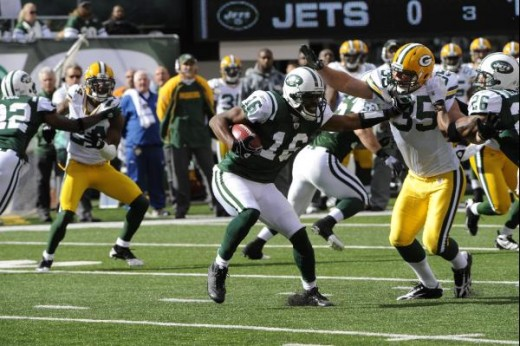 New York Jets' Brad Smith carries the ball during the first quarter of an NFL football game between the Green Bay Packers and the New York Jets at New Meadowlands Stadium Sunday, Oct. 31, 2010, in East Rutherford, N.J. (AP Photo/Bill Kostroun)