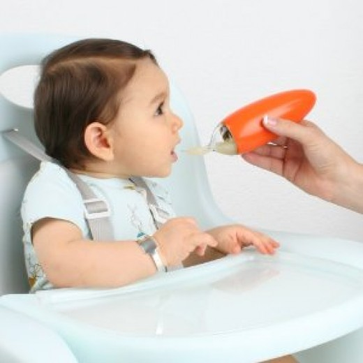 Boon Squirt Baby Food Dispensing Spoon in Orange
