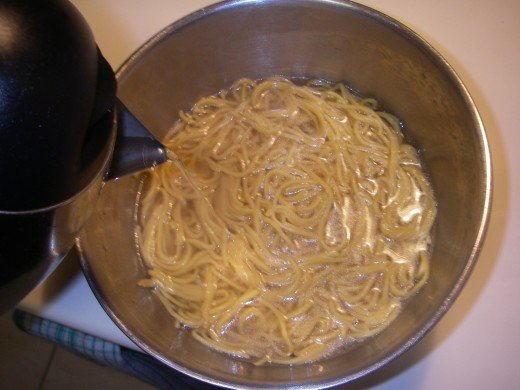 Place noodles in a bowl and cover with boiling water.