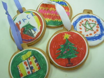 Decorated with Royal icing & painted with food coloring, using a small paint brush