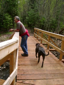 Doug's friend, Brett Mcclure,(since age 5) walking with Doug's remaining dog, Chyna, in the forest area that Doug loved so much.