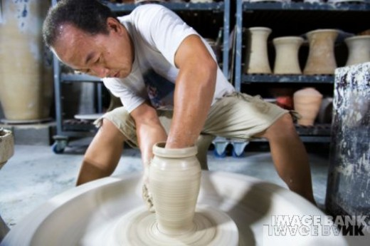 Chinese Potter working on Vase