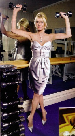 Ivana Trump, mother of Ivanka Trump, wearing a bold necklace and silver satin dress with matching heels and lifting two silver barbells