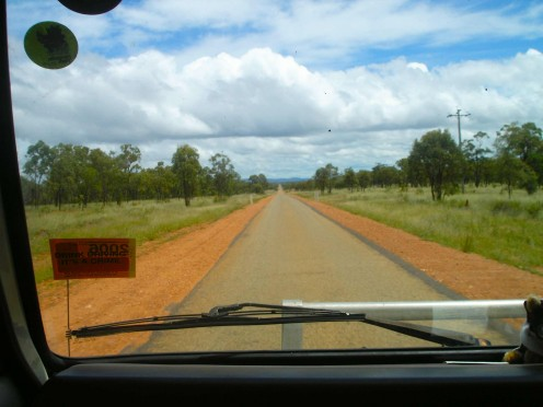 A single lane of ragged asphalt sandwiched between the red earth of Australia.