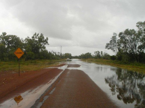 The flooded road stretches ahead, but how deep does it get?