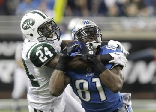 New York Jets cornerback Darrelle Revis (24) breaks up a pass intended for Detroit Lions wide receiver Calvin Johnson (81) during the first quarter of an NFL football game at Ford Field in Detroit, Sunday, Nov. 7, 2010. (AP Photo/Carlos Osorio)
