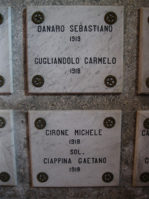 Close-up of plaques for individual World War I soldiers killed in action and entombed in the crypt