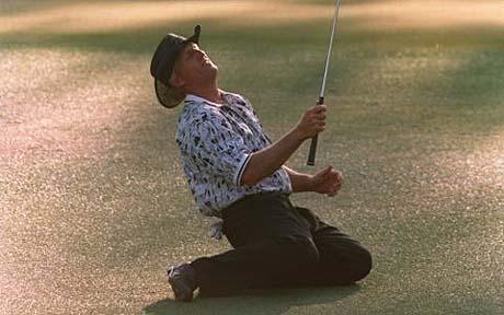 Norman sinks to his knees at the 1996 US Masters