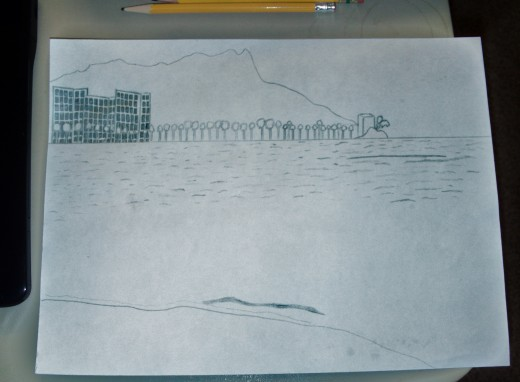 In this stage of the sketch I have begun to add more details, such as the windows on the high rise hotels, and the ripples in the Pacific Ocean near the shore of Waikiki.