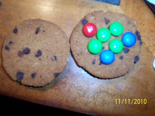 Add a small amount of M&M's to one side of the cookie.