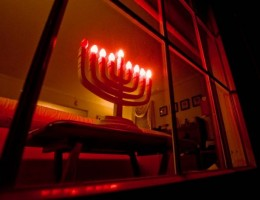 An electric menorah in the window of a Jewish home