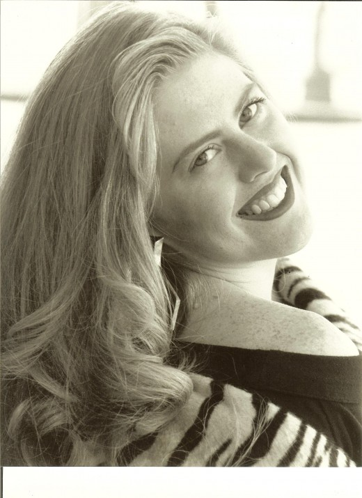 Me, in my modeling days.  :)  This is a genuine smile because I was doing what I truly loved.