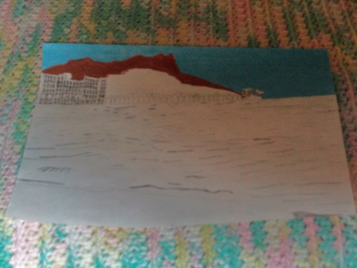 Now I am using my amber and sepia colored pencils to shade in the hues of Diamond Head.