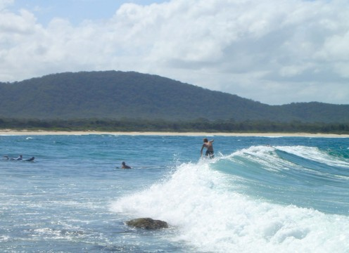 Surfing close to the rocks