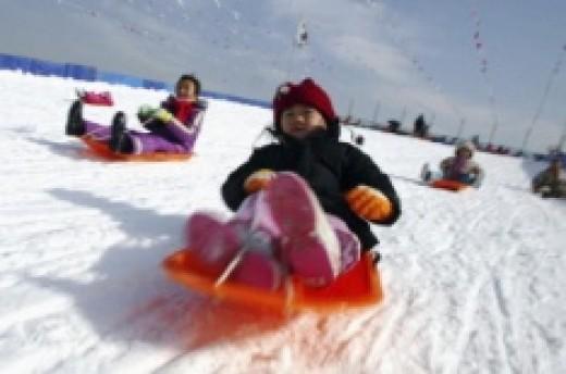 Tobogganing is one of the must fun winter activities.