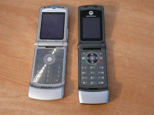 Motorola Razr next to the Motorola W370 from Tracfone.