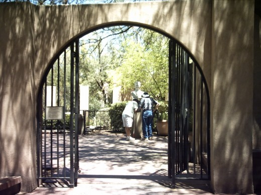 Gate at entrance to the sculptures in Tucson's Garden of Gethsemane Felix Lucero Park.