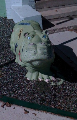 The High School Mascot is the hippo! This hippo sits outside a flower/gift shop.