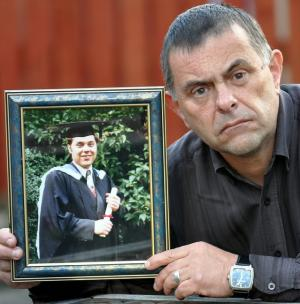 Maro Zawodny with a graduation picture of his son Morgen. Suicide - The Grieving Father