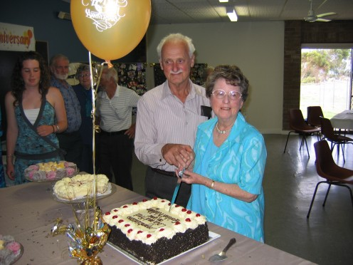 Cutting the cake on their 50th Wedding Anniversary