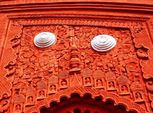 Terracotta work on the arch of main entrance to Ananda Bhairabi temple