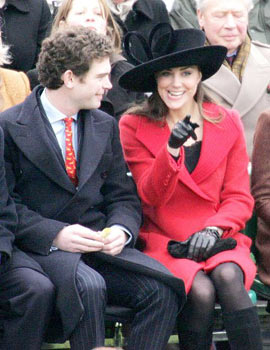 Kate was smashing in a red coat and black hat at Prince William's graduation from Sandhurst.