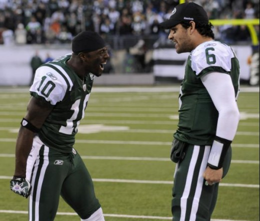 New York Jets quarterback Mark Sanchez (6) and teammate Santonio Holmes (10) celebrate after they connected for the game-winning touchdown during the fourth quarter of an NFL football game against the Houston Texans at New Meadowlands Stadium, Sunday