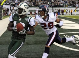 New York Jets wide receiver Santonio Holmes (10) catches the game-winning touchdown-pass as Houston Texans cornerback Glover Quin (29) pursues during the fourth quarter of an NFL football game at New Meadowlands Stadium, Sunday, Nov. 21, 2010, in Eas