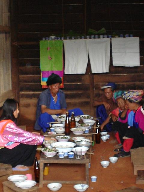 A Lisu Family enjoying a holiday feast