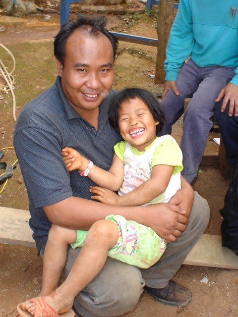 Pi Ouan with his daughter from his first marriage.