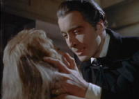 Christopher Lee, as Dracula, seduces Melissa Stribling, as Mina Holmwood in the 1958 film Dracula.