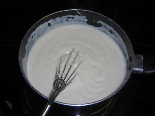 Stir the ricotta cheese into the white sauce until smooth