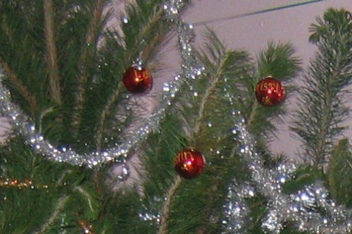 Each bauble is etched in gold glitter with a child's name