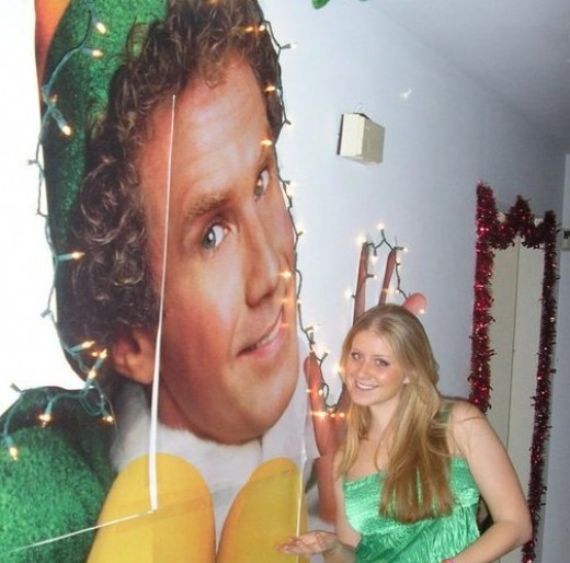 2nd PLACE - A Huge BUDDY Christmas Light Decoration on the Wall with a Huge Fan of BUDDY