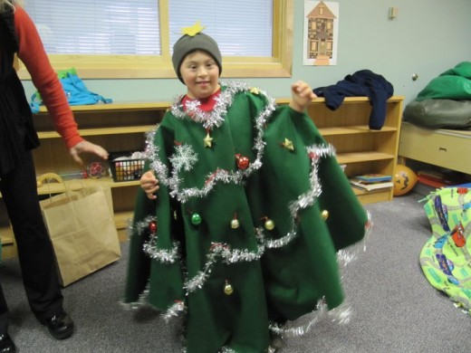 1st PLACE - A BUDDY THE ELF Fan Sharing In His Love For Christmas, Spreading Christmas Cheer As He Is Decorated As A Christmas Tree