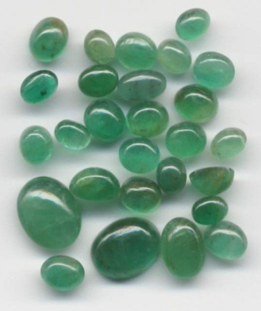 Smooth, polished emeralds, or cabochons.