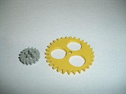 Lego Technics 16 tooth gear versus homemade 30 tooth gear out of PVC sheet (yellow)