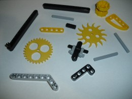 An assortment of Lego Technic parts intermixed with homemade PVC gears to help get the job done faster.