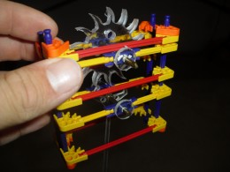 K'Nex construction blocks, used instead of Legos, along with some custom designed parts made of poly carbonate.