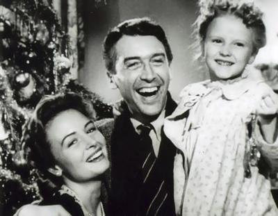 "Donna Reed, James Stewart and Karolyn Grimes in ""It's a Wonderful Life."""