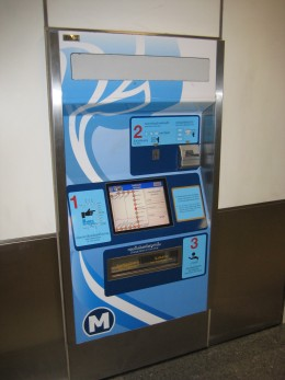 Touch screen ticket vending machine - Accepts coins and small bills - English instructions are available on the machine