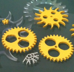 Custom gears and clock parts intended for use with K'Nex assembly parts.