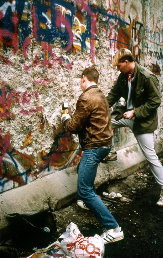 Chipping off a piece of Berlin Wall. Not an easy task... I still have a piece of it!