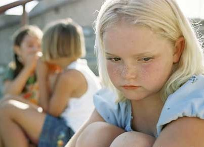 A young girl is excluded and verbally abused by her peers.