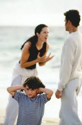 Couple arguing in front of their child.