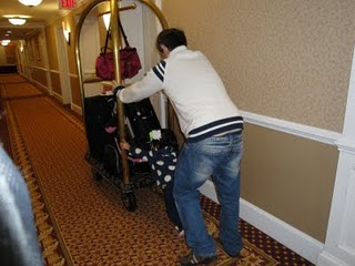 Man in jeans pushing a hotel luggage cart