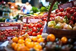 English Photograph of tomatoes on a vegetable stall at Borough Market in London, UK.  November 28, 2009